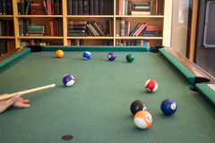 Billiards table. In livingroom interior with library royalty free stock photography