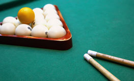 Billiards. Top view of billiard balls and cues. On green table Stock Photography