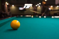 Billiards tournament. The game of American and Russian billiards. Pool table, ball and cue. Sports leisure. Friendly tournament. Winter fun. Green cloth in royalty free stock image