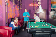 Billiards. Young people playing billiards in the club Stock Images