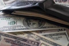 Billie-Dollar mit Geldbörse stockbild