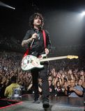 Green Day performs in concert stock image