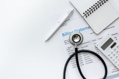 Billing statement for for medical service in doctor`s office background top view mock up. Billing statement for for medical service in doctor`s office on white Royalty Free Stock Image
