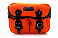 Billingham Hadley small shoulder bag on Neon Orange with black leather trim Stock Images