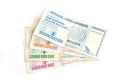 Billion dollar bank notes. Pile of colorful billion Zimbabwean dollar banknotes isolated on white background Stock Images