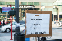Billionaires should be illegal. Seattle, WA, USA Jan. 15, 2017: Protest sign against billionaires in front of Starbucks in Seattle, WA Stock Photo