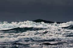 Billow. Stormy waves on the surface of the ocean Stock Images