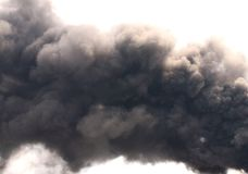 Soot. Black smoke. Billowing Black Smoke from ignition midden Stock Images