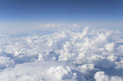 The billowing clouds. View of white clouds from the plane Stock Images
