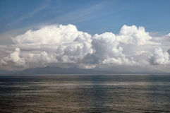 Billowing Clouds On Ocean At Sunset. Billowing white clouds from deck of cruise ship in Alaska stock photos