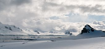 Billowing clouds over snow-covered mountains and icebergs, Livingstone Island, Antarctic Peninsula stock photography