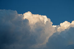 BILLOWING LAYERS OF CLOUD. Voluminous dense white cumulus clouds royalty free stock images