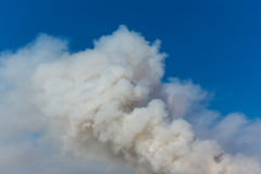 Billowing Smoke. With blue sky Royalty Free Stock Photography