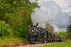 Billowing steam passenger train royalty free stock photography
