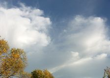 Billowy clouds. On a fall day Royalty Free Stock Image