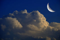 Billowy Night Clouds and Crescent Moon Royalty Free Stock Image
