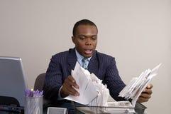 Bills. A man looks through the bills in shock Royalty Free Stock Photos