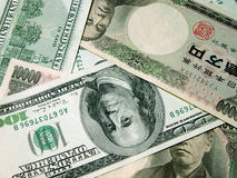 Bills. Some American and Japanese bills(100 dollar and 1000 yen Royalty Free Stock Photography
