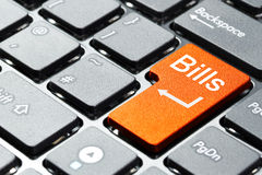 Bills button on the keyboard. Orange bills button on the keyboard Stock Image
