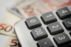 Bills and calculator Stock Photos