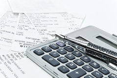 Bills and calculator. Many bills and calculator on the white background Royalty Free Stock Photo