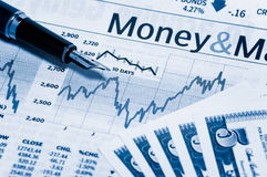 Bills and chart 2. A stock market chart with a nice pen and some bills Royalty Free Stock Photography