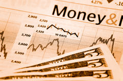 Bills and chart. A stock market chart with some bills Royalty Free Stock Photography