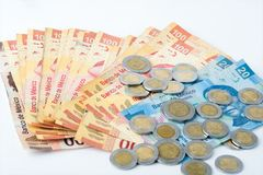 Bills and coins accumulated by a person over a certain period of time,. Mexican currency stock images