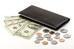 Bills coins and check book Royalty Free Stock Image