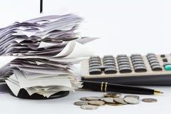 Bills on desk Stock Images