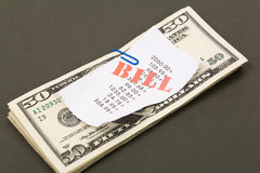 Bills and dollars Stock Image