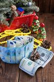 Bills of dollars, euro and christmas decorations. New year`s gifts Stock Image