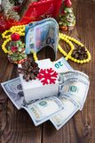 Bills of dollars, euro, gift box and christmas decorations. New year`s gifts Stock Photography