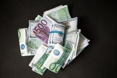Dollars and euros. Bills dollars and euros scattered in disarray royalty free stock photography