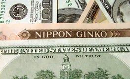 Bills inscriptions. Inscription on the 100 dollars bill and 10000 yens bill(Nippon Ginko=Japan Bank Stock Photo