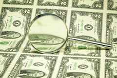 $2 bills and magnifying glass on them Royalty Free Stock Image