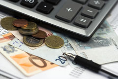 Bills,pen and calculator Stock Image