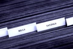 Bills and Savings Filing Tabs Royalty Free Stock Photo