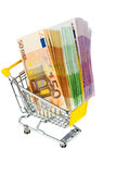 Bills in a shopping cart. Euro bank notes in a shopping cart icon photo for purchasing power, shopping, money printing and inflation Stock Photo