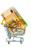 Bills in a shopping cart. Euro bank notes in a shopping cart, photo icon for purchasing power, shopping, money printing and inflation Stock Photography