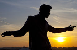 Billy Fury Statue at Albert Dock in Liverpool. The silhouette of a statue dedicated to legendary British singer Billy Fury located on the Albert Dock in stock photography