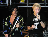 Billy Idol And Steve Stevens. Rocker Billy Idol and guitarist Steve Stevens  performing in concert at The Stone Pony in Asbury Park, New Jersey, on September 12 Royalty Free Stock Image