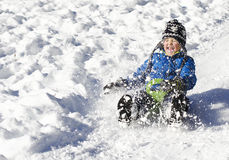 Young boy sledging Stock Image