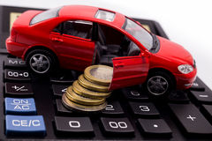 Bilmodell och mynt Arkivfoton