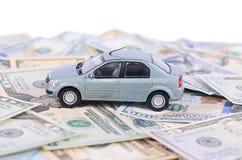 Bilmodell på dollarräkningar Fotografering för Bildbyråer