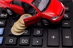 Bilmodell på räknemaskinen Royaltyfria Bilder