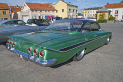 Am-bilmötet halden in (Chevrolet Impala 1961) Arkivbild