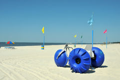Biloxi Beach. Lounge chairs, umbrellas, and oversized trikes scattered along Biloxi Beach in Mississippi on a spring day stock photo