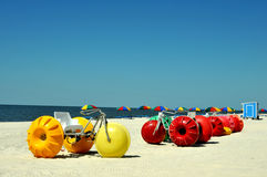 Biloxi Beach. Lounge chairs, umbrellas, and oversized trikes scattered along Biloxi Beach in Mississippi on a spring day royalty free stock image