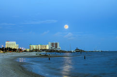 Biloxi, Mississippi, casinos and buildings in night image with rising moon Stock Photos
